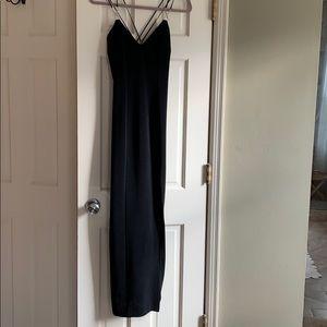 Strappy black dress with rhinestone details
